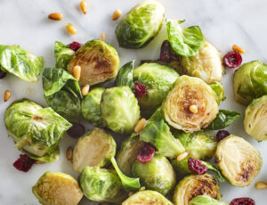 Maple Syrup Roasted Brussels Sprouts with Dried Cranberries and Pine Nuts